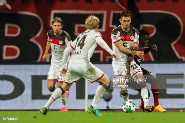 Johannes Flum of St Pauli und Edgar Nicaise Constant Salli of Nuernberg battle for the ball during the Second Bundesliga match between 1 FC Nuernberg...