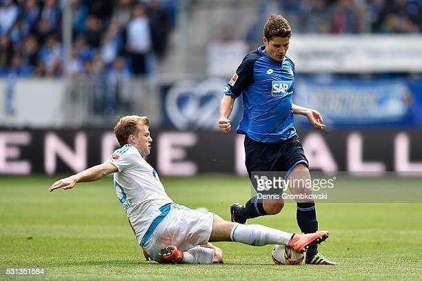 Johannes Geis of FC Schalke 04 challenges Primin Schwegler of 1899 Hoffenheim during the Bundesliga match between 1899 Hoffenheim and FC Schalke 04...