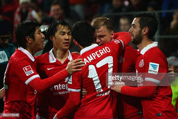 Johannes Geis of Mainz celebrates his team's first goal with team mates during the Bundesliga match between 1 FSV Mainz 05 and VfB Stuttgart at...