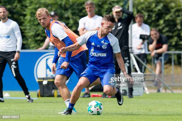 Johannes Geis of Schalke and Donis Avdijaj of Schalke battle for the ball during a training session at the FC Schalke 04 Training center on July 5...
