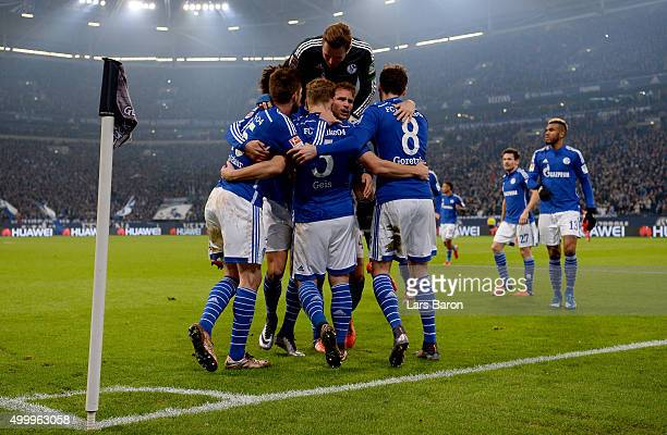 Johannes Geis of Schalke celebrates with team mates after scoring his teams first goal during the Bundesliga match between FC Schalke 04 and Hannover...