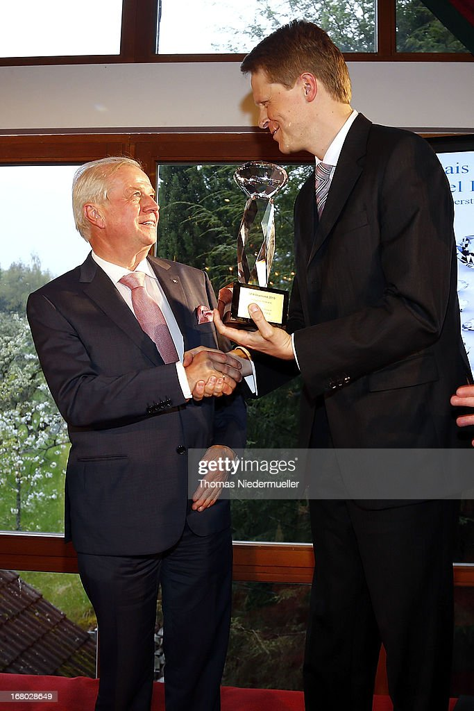 Johannes Grosspietsch (R) hands the award over to Meinrad Schmiederer (L) during the Spa Diamond Award 2013 on May 4, 2013 in Bad Peterstal-Griesbach, Germany.