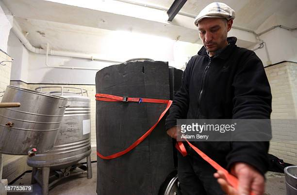 Johannes Heidenpeter owner of Heidenpeters brewery secures insulation around a lauter tun while brewing Thirsty Lady American Pale Ale beer on...