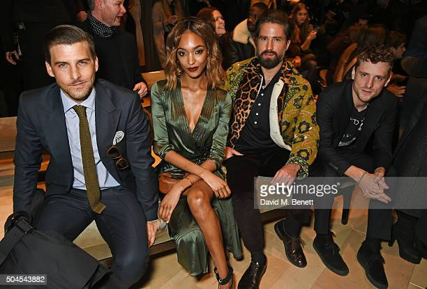 Johannes Huebl Jourdan Dunn Jack Guinness and George Barnett attend the Burberry Menswear January 2016 Show on January 11 2016 in London United...
