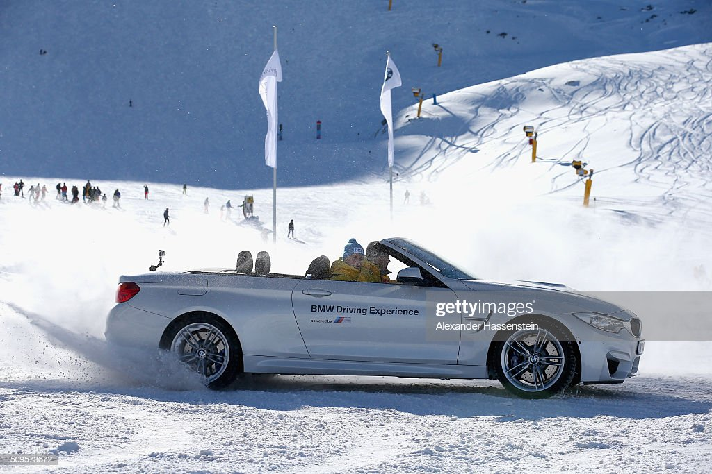 Johannes Lochner (L) and <a gi-track='captionPersonalityLinkClicked' href=/galleries/search?phrase=Francesco+Friedrich&family=editorial&specificpeople=7507384 ng-click='$event.stopPropagation()'>Francesco Friedrich</a> drives in a BMW during the BMW Snow Driving Experience prior to the IBSF World Championship 2016 on February 11, 2016 in Soelden, Austria.