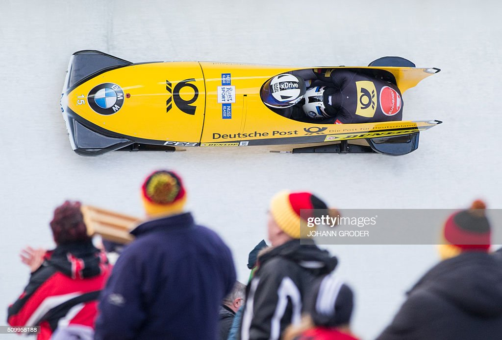 Johannes Lochner and Joshua Bluhm of Germany compete during the second run of the two-men Bobsleigh event of the Bobsleigh and Skeleton World Championships in Innsbruck/Igls, Austria, February 13, 2016. / AFP / APA / Johann Groder / Austria OUT