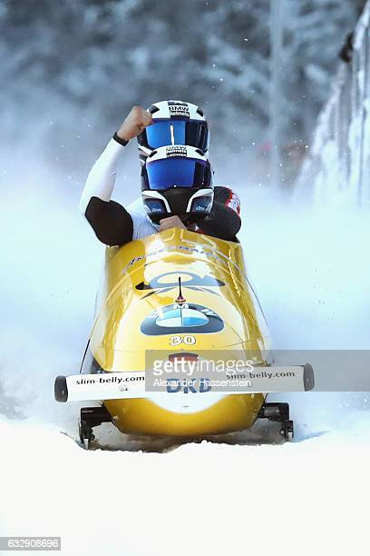 Johannes Lochner and Joshua Blum of Germany celebrate victory after the second run of the 2man Bobsleigh BMW IBSF World Cup at Deutsche Post Eisarena...