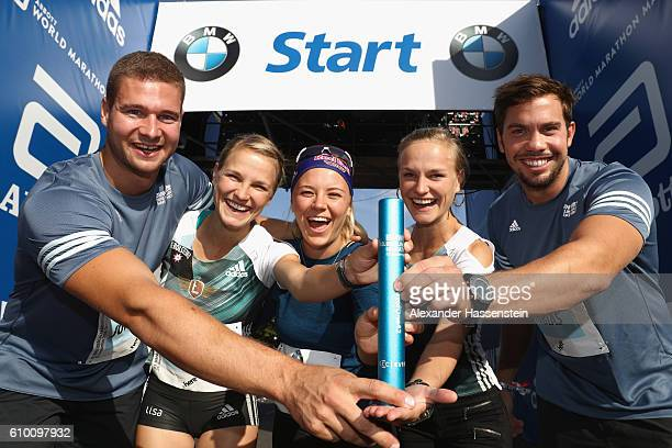 Johannes Lochner Lisa Hahner Miriam Goessner Anna Hahner and Tobias Wendl all members of the BMW Wintersport relay team pose with a BMW i8 the...