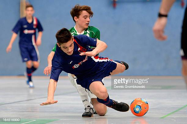 Johannes Pex of Fuerth challenges Samuel Schmitt of Hollenbach during the DFB C Juniors Futsal Cup semifinal match between SpVgg Greuther Fuerth and...