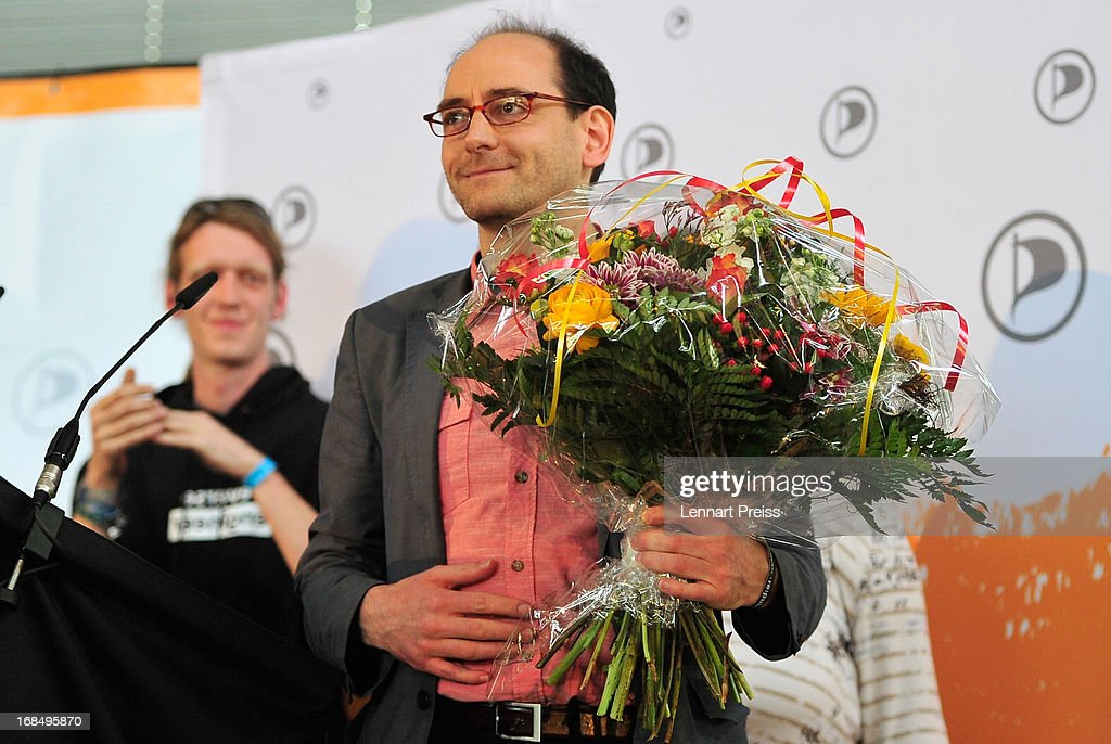 Johannes Ponader, former political manager of the German Pirates Party (Die Piraten) reacts after his speech at the party's federal congress on May 10, 2013 in Neumarkt, Germany. The Pirates rode a wave of popularity driven by voter discontent with Germany's established political parties that won the Pirates seats in several state parliaments. More recently, however, the Pirates have faltered, as political infighting, leadership changes and an unclear political message have contributed to a loss of support. Germany faces federal elections in September and at current polls the Pirates would fail to pass the 5% hurdle necessary to gain seats in the Bundestag.
