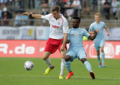 Johannes Rahn of Fortuna and Reagy Ofosu of Chemnitz fight for the ball during the Third Bundesliga match between Fortuna Koeln and Chemnitzer FC at...