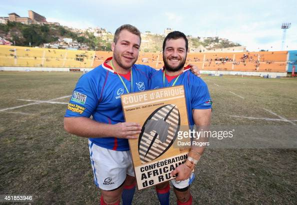 Johannes Redelinghuys celebrates with team mate Rohan Kitsshoff afer Nambia qualify for the RWC finals during the Rugby World Cup 2015 qualifying...