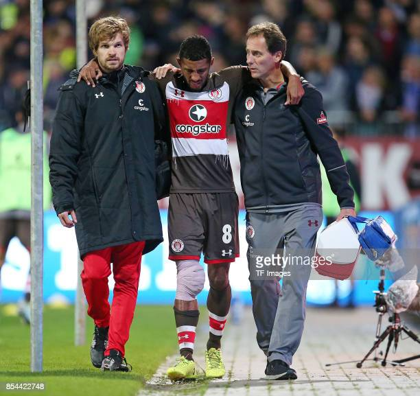 Johannes Reich of FC St Pauli and Jeremy Dudziak of FC St Pauli and Dr Volker Carrero of FC St Pauli looks on during the Second Bundesliga match...