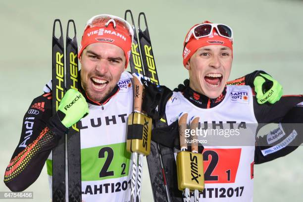 Johannes Rydzek and Eric Frenzel from Germany celebrate after they win Team Sprint LH / 2 x 77 km in Nordic Combined at FIS Nordic World Ski...