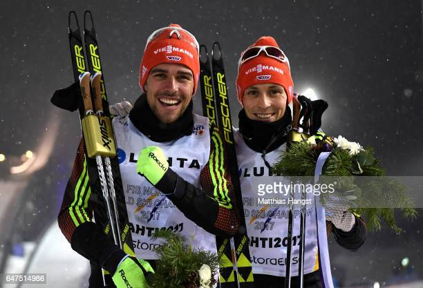Johannes Rydzek and Eric Frenzel of Germany celebrate winning the gold medal during the flower ceremony for the Men's Nordic Combined HS130 Ski...