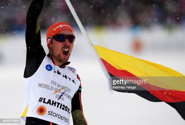 Johannes Rydzek of Germany celebrates after winning the gold medal in the Men's Nordic Combined Team HS 100 4 x 50km CrossCountry Sprint during the...