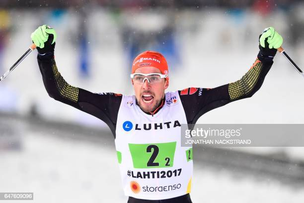 Johannes Rydzek of Germany celebrates victory after the nordic combined team sprint 2x 75 km competition at the FIS Nordic Ski World Championship in...