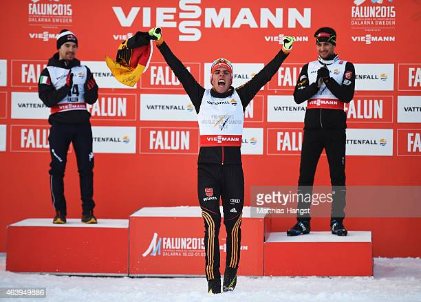 Johannes Rydzek of Germany celebrates winning the gold medal with silver medallist Alessandro Pittin of Italy and bronze medallist Jason Lamy...