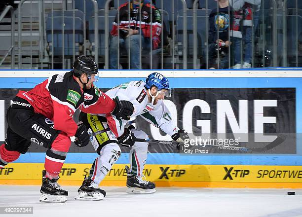 Johannes Salmonsson of the Koelner Haie and Thomas Holzmann of the Augsburger Panther during the DEL game between Koelner Haie and the Augsburger...