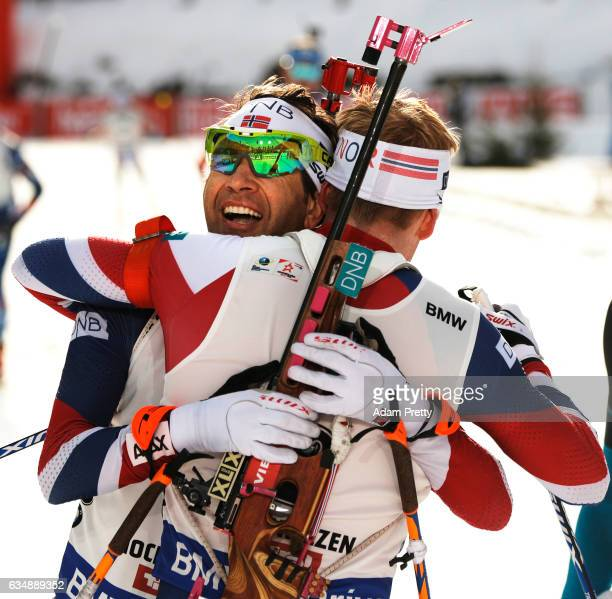 Johannes Thingnes Boe of Norway celebrates silver and congratulates Ole Einer Bjoerndalen of Norway who won bronze in the Men's 125km pursuit...