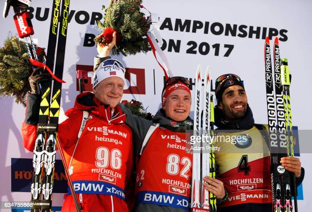 Johannes Thingnes Boe of Norway celebrates winning the silver medal Benedikt Doll of Germany celebrates the gold and Martin Fourcade of France...