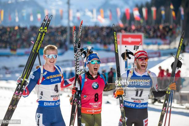 Johannes Thingnes Boe of Norway Simon Schempp of Germany and Simon Eder of Austria pose for a picture during the victory ceremony of the men's 15km...