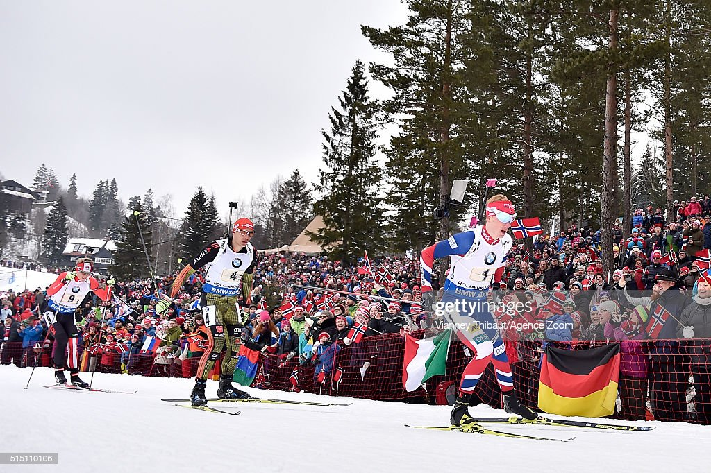 Johannes Thingnes Boe of Norway wins the gold medal Arnd Peiffer of Germany wins the silver medal Scott Gow of Canada wins the bronze medal during...