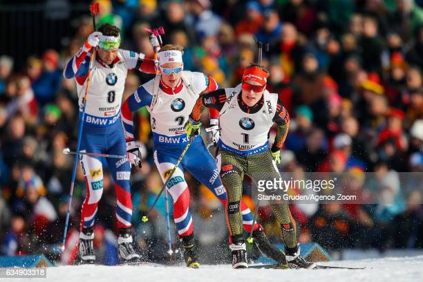 Johannes Thingnes Boe of Norway wins the silver medal Benedikt Doll of Germany in action during the IBU Biathlon World Championships Men's and...