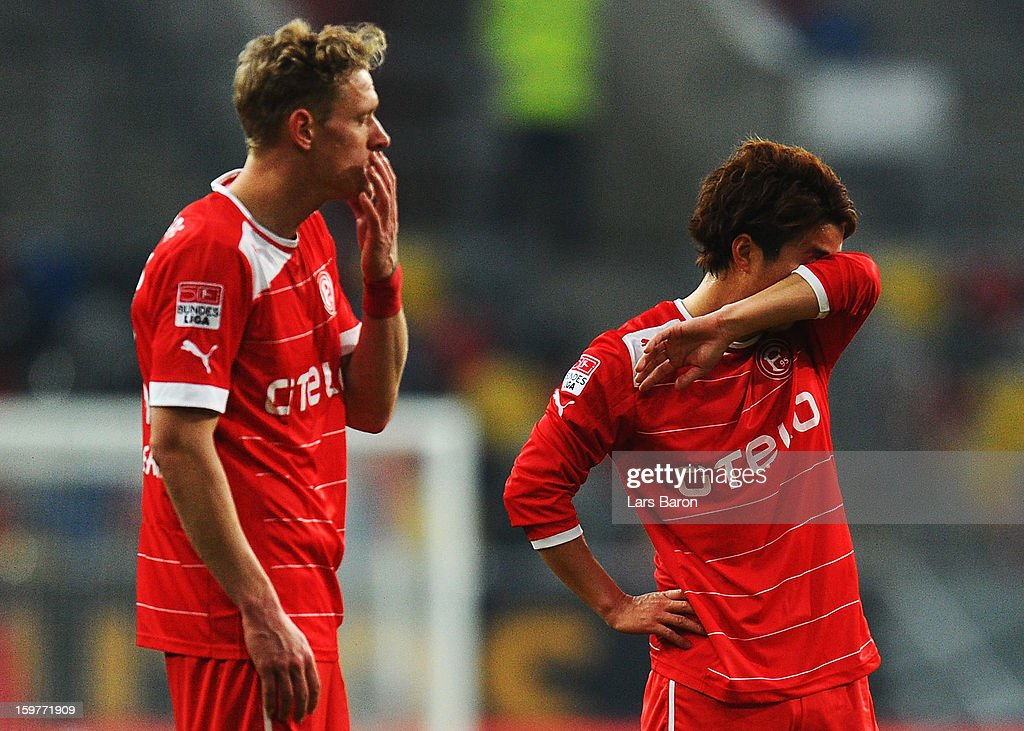 Johannes van den Bergh and Genki Omae of Duesseldorf are looking dejected during the Bundesliga match between Fortuna Duesseldorf 1895 and FC Augsburg at Esprit-Arena on January 20, 2013 in Duesseldorf, Germany.