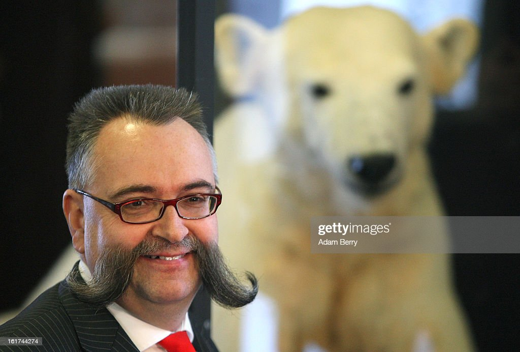 Johannes Vogel, director of the Natural History Museum (Naturkundemuseum) in Berlin, stands in front of a model of Knut the polar bear on display on February 15, 2013 in Berlin, Germany. Though Knut, the world-famous polar bear from the city's zoo abandoned by his mother and ultimately immortalized as a cartoon film character, stuffed toys, and more temporarily as a gummy bear, died two years ago, he will live on additionally as a partially-taxidermied specimen in the museum. Until March 15, the dermoplastic model of the ursine celebrity featuring his original fur will be on display before it joins the museum's archive, though visitors can see it once again as part of a permanent exhibition that begins in 2014.