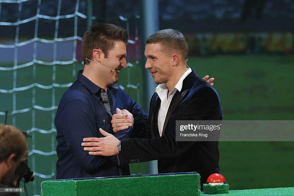 Johannes Witzenrath and Lukas Podolski attend Wetten, dass..? tv show on November 09, 2013 in Halle an der Saale, Germany.