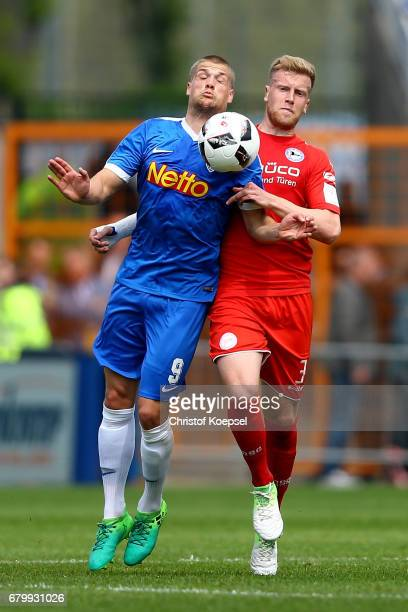 Johannes Wurtz of Bochum and Brian Behrendt of Bielefeld go up for a header during the Second Bundesliga match between VfL Bochum 1848 and DSC...