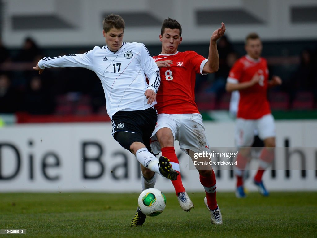 Johannes Wurtz of Germany is challenged by Remo Freuler of Switzerland during the International Friendly match between U20 Germany and U20 Switzerland on March 22, 2013 in Cologne, Germany.
