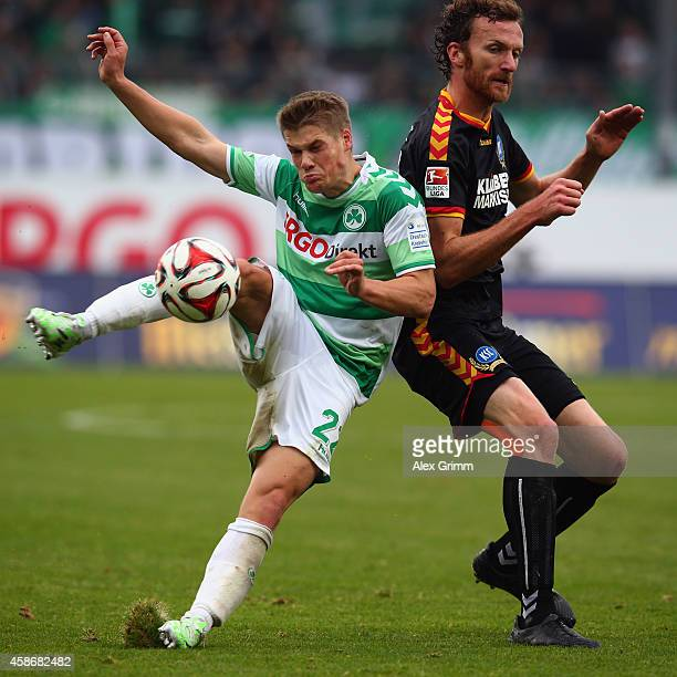 Johannes Wurtz of Greuther Fuerth is challenged by Dominic Peitz of Karlsruhe during the Second Bundesliga match between Greuther Fuerth and...