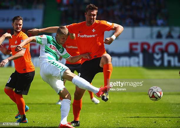 Johannes Wurtz of Greuther Fuerth is challenged by Ronny Koenig of Darmstadt during the Second Bundesliga match between SpVgg Greuther Fuerth and SV...