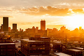 Johannesburg city with the sun setting in the background