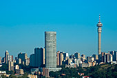 A Southern view of Johannesburg over Doornfontein with tall buildings and tower.
