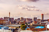 "Johannesburg panorama from the M2 motorway. Also known as Jozi, Jo'burg or eGoli, ""city of gold"" is the largest city in South Africa. It is the provincial capital of Gauteng, the wealthiest province i"
