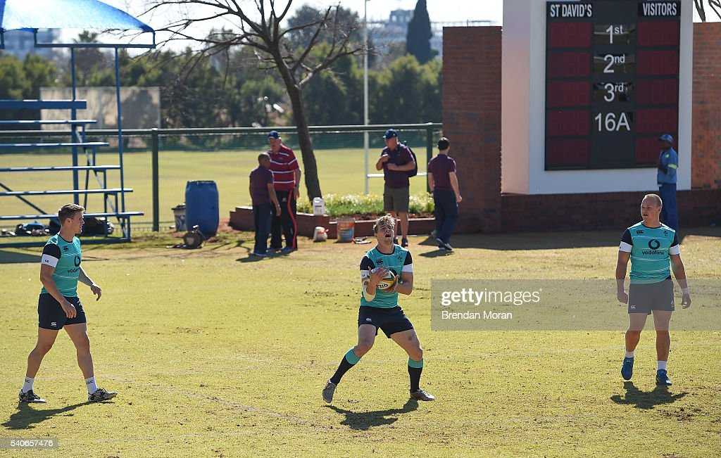 Johannesburg South Africa 16 June 2016 Andrew Trimble of Ireland catches a kick watched by Craig Gilroy left and Luke Marshall right during squad...