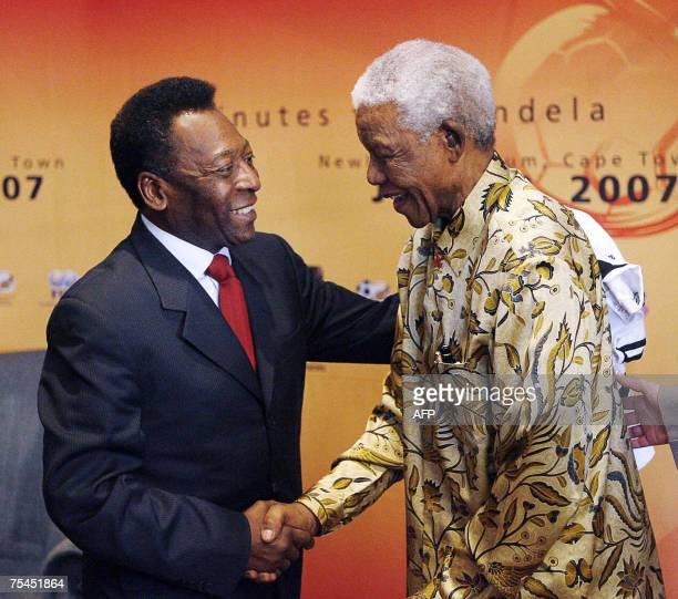 Brazilian football legend Pele shakes hands 17 July 2007 with former South African President Nelson Mandela in Johannesburg South Africa Pele is in...
