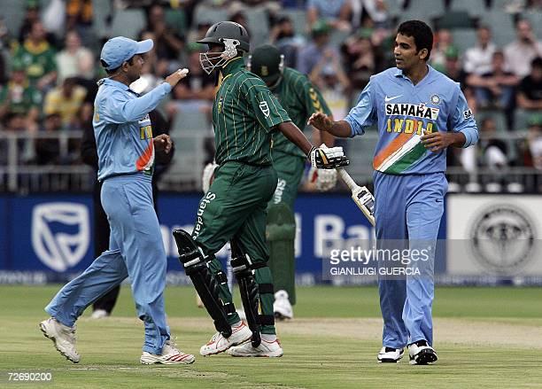 Indian bowler Zaheer Khan is congratulated by Indian Captain Virendar Sehwag 1 December 2006 after sending out South African batsman Loots Bosman...
