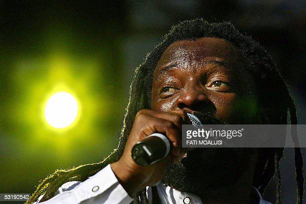 South African reggae singer Lucky Dube performs at the global call concert against poverty in Johannesburg South Africa 02 July 2005 AFP PHOTO/FATI...
