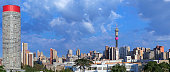 Johannesburg sunrise cityscape of Hillbrow in South Africa. The Hillbrow Tower and Ponte City apartments on the left dominates the Johannesburg city skyline, featured in many picture postcard views of