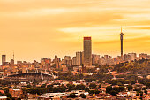 Johannesburg cityscape panorama in the late afternoon with Hillbrow residential suburb and the iconic Hillbrow communication tower and Ponte apartments. Johannesburg is one of the forty largest metrop