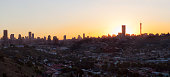Johannesburg Sunset silhouette from the east, with the sun setting behind ponte city apartments. The city is also known as Jozi, Jo'burg or eGoli, is the largest city in South Africa. It is the provin