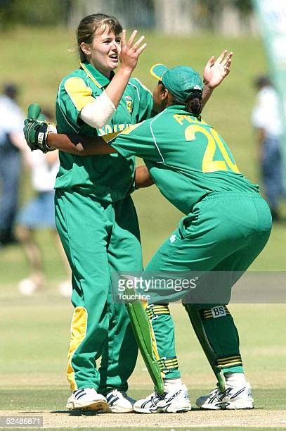 Johmari Logtenberg and Shafeeqa Pillay of South Africa celebrate the wicket of Belinda Clark during the Womens Cricket World Cup match between South...