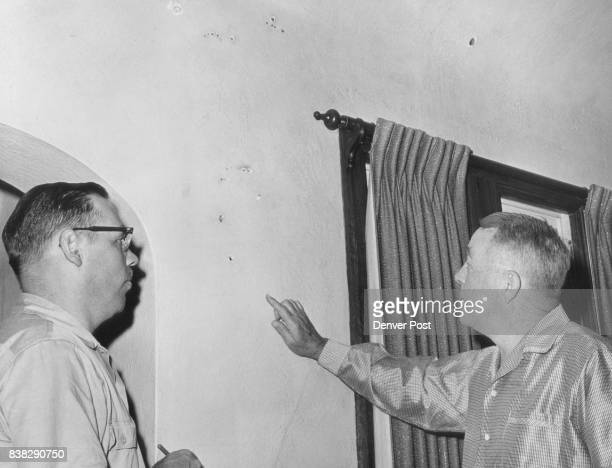 John A Carroll Points to Pock Marks on Wall of His Living Room Lightning struck and sent a shower of sparks that made more than 35 small holes Credit...