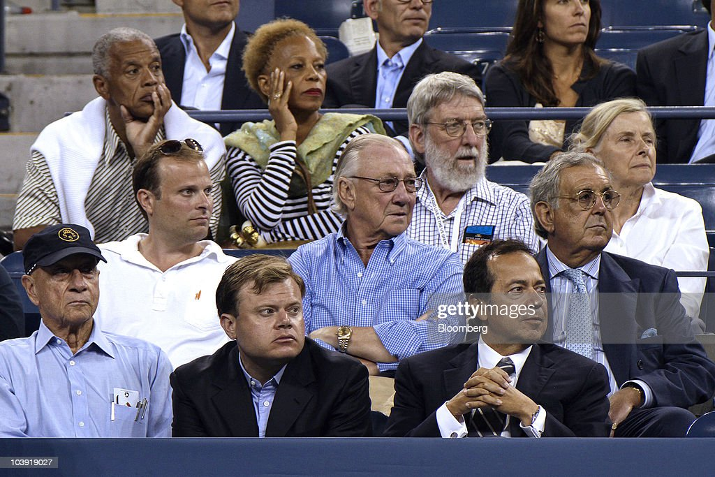 John A Paulson president of Paulson Co bottom right attends a US Open match between Venus Williams and Francesca Schiavone at the Billie Jean King...