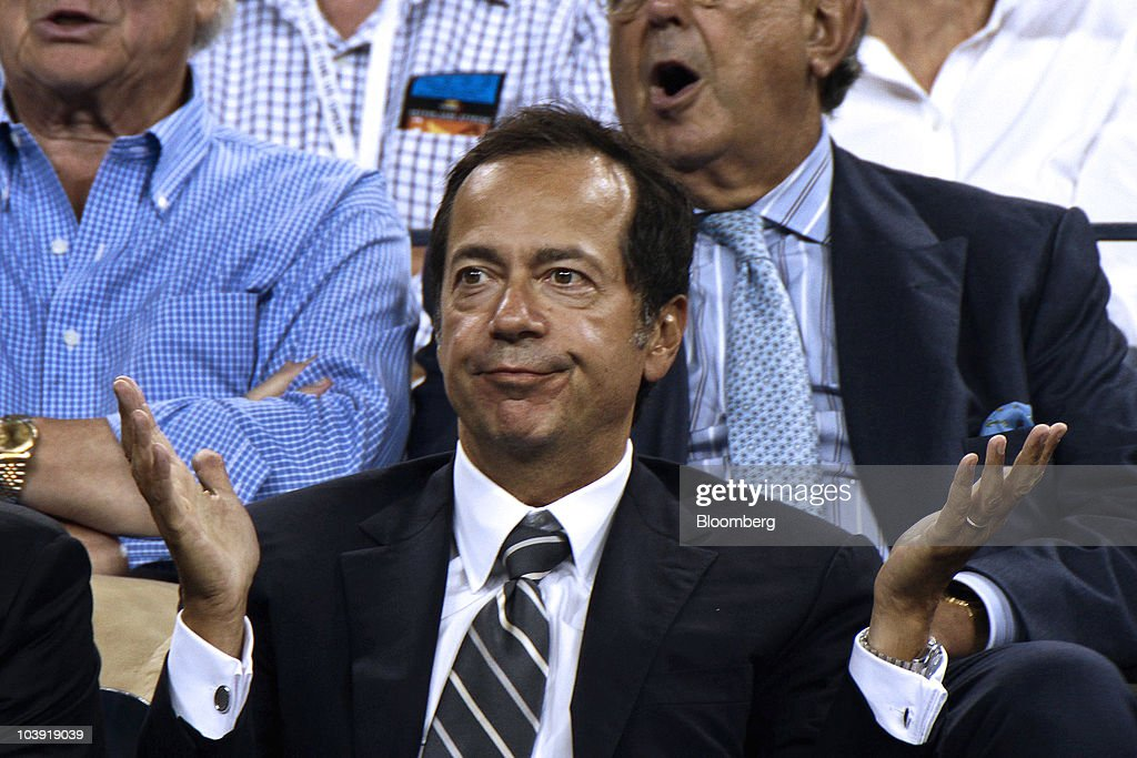 John A Paulson president of Paulson Co reacts during a US Open match between Venus Williams and Francesca Schiavone at the Billie Jean King National...