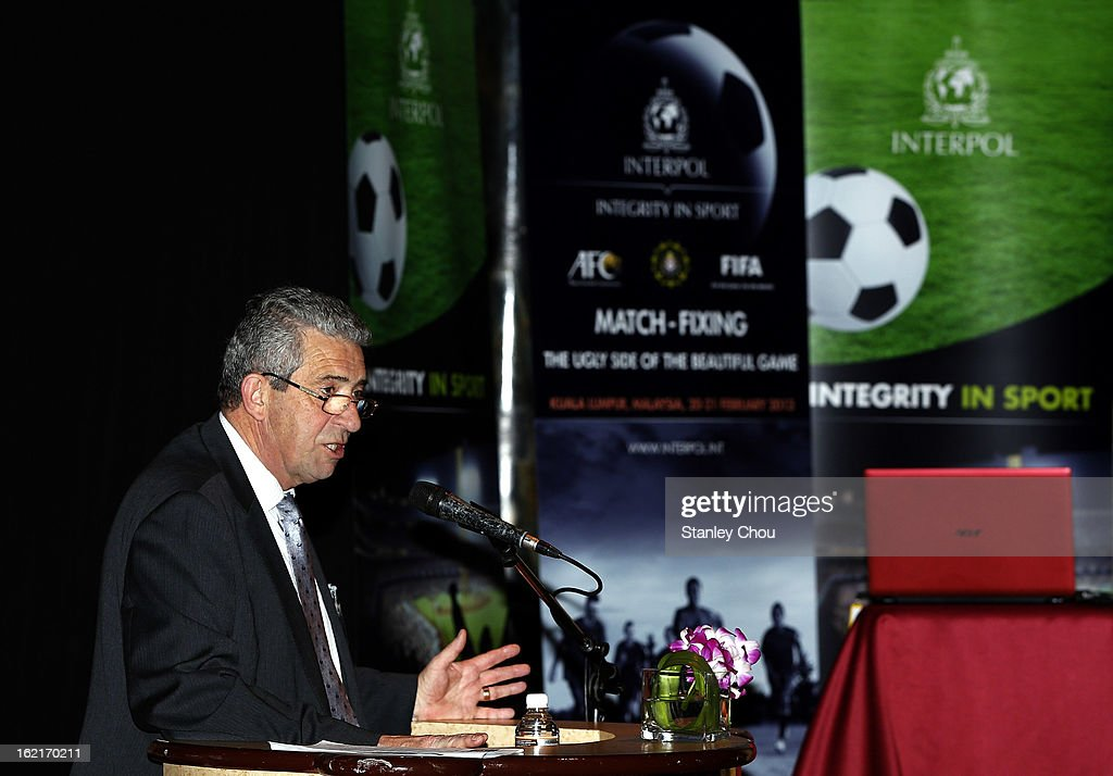John Abbott, Chairman of Interpol Integrity in Sport Steering Group speaks during an INTERPOL (International Criminal Police Organization) conference at AFC House on February 20, 2013 in Kuala Lumpur, Malaysia. Law enforcement officials and representatives from football associations gather in Malaysia to discuss 'Match fixing: The Ugly Side of the Beautiful Game'.